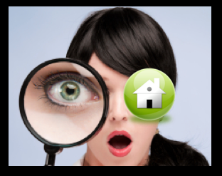Woman looking through a magnifying glass looking at housing stats