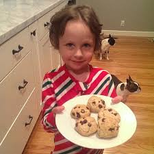 little girl with a plate of cookies