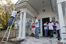 5 People Painting The Exterior of a House